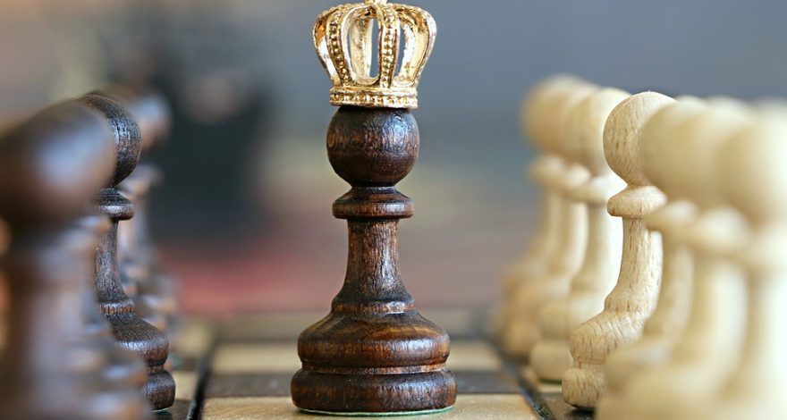 chess board with crowned pawn