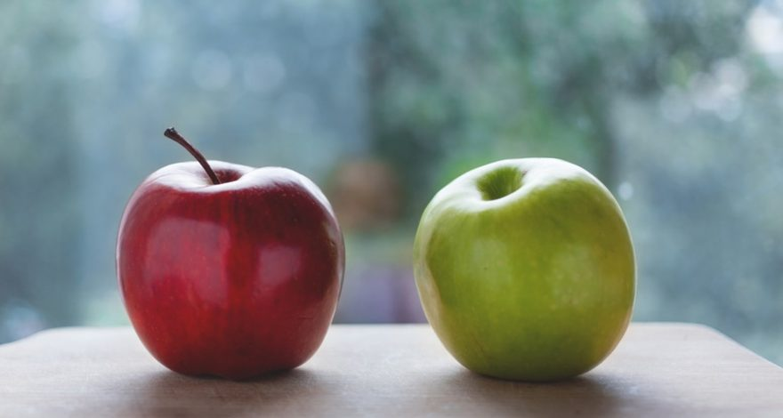 two different apples sitting side-by-side