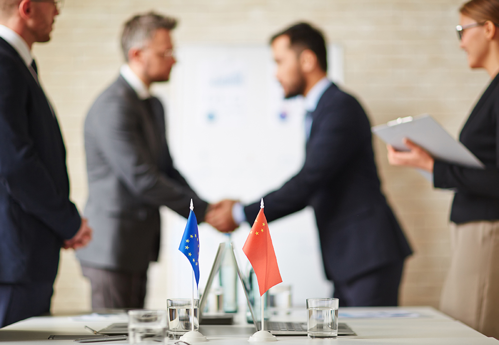 Shaking Hands After an International Deal is Made With the Help of Consecutive Interpreters