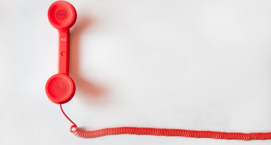red telephone for emergency calls requiring telephonic interpretation