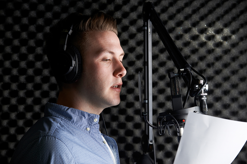 Man Recording Voice Over in Booth