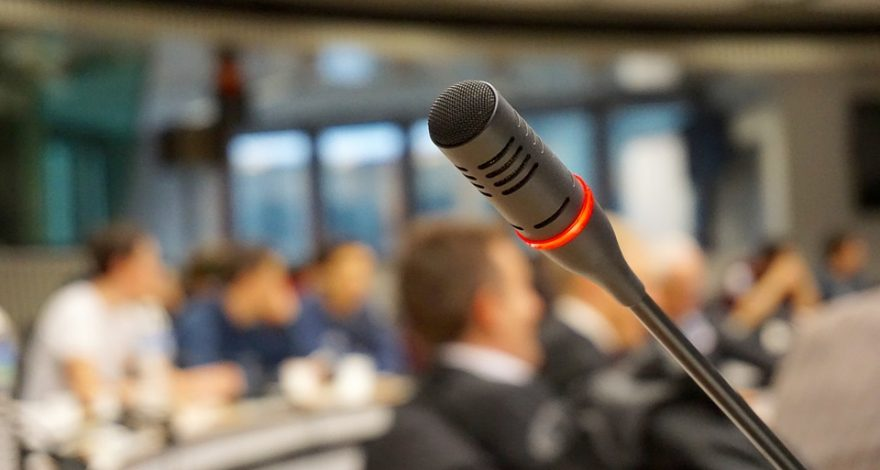 simultaneous interpreting microphone in use at conference