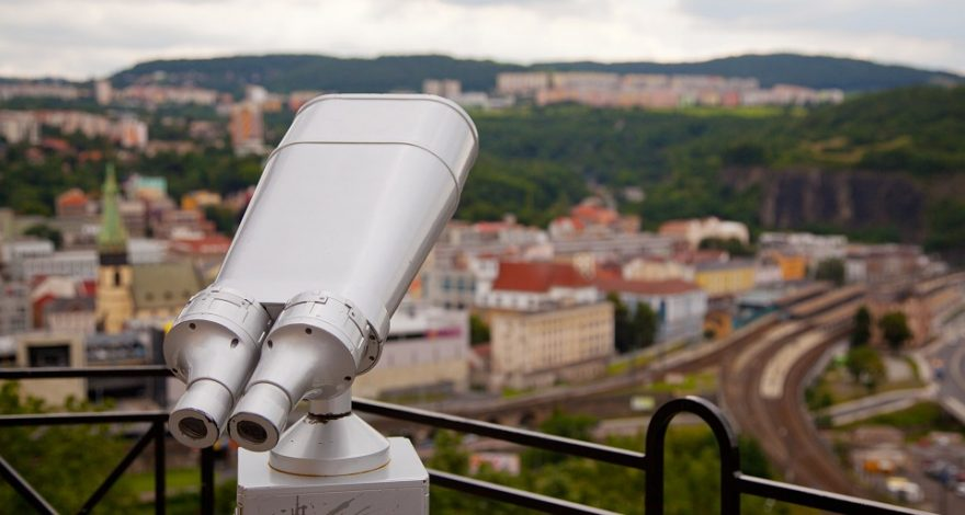 observation scope above a city skyline