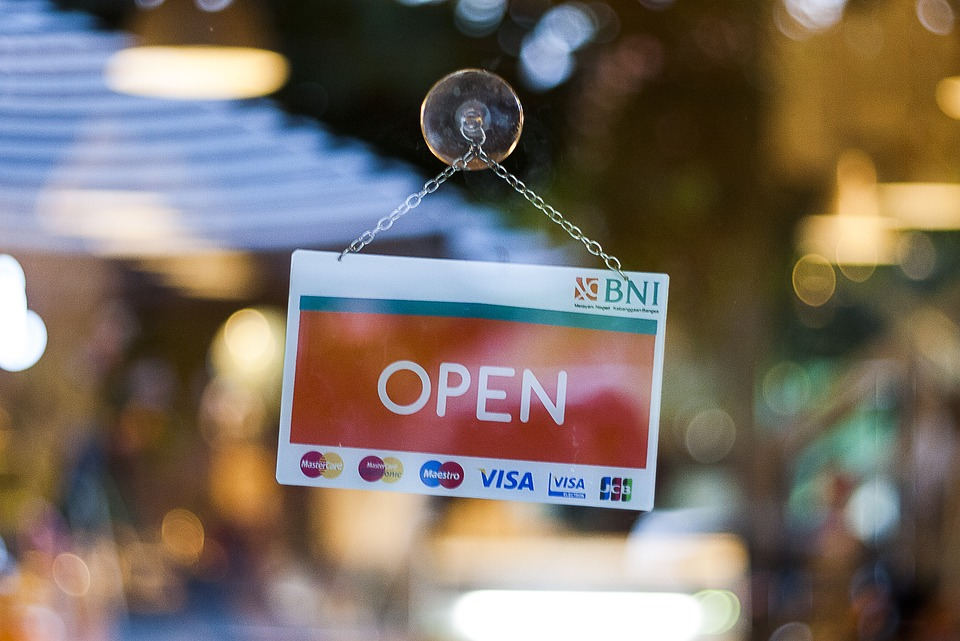 open sign on store front
