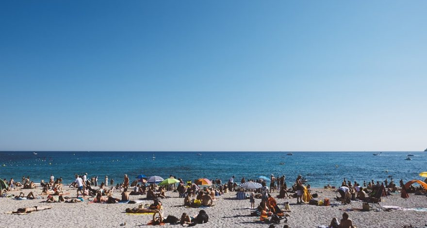 Tourists on a beach during the summer season