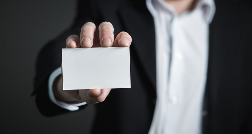 man holding a blank business card