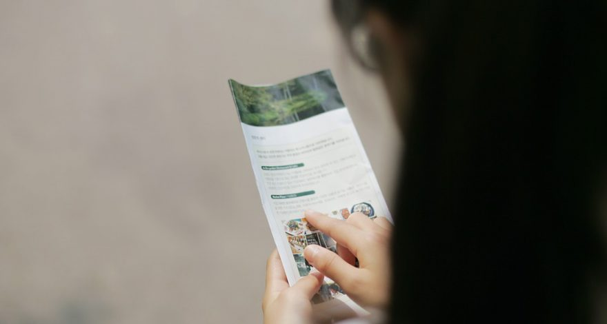 woman reading a brochure translated into her native language