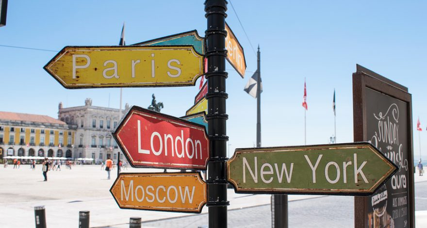 sign post with different major world cities